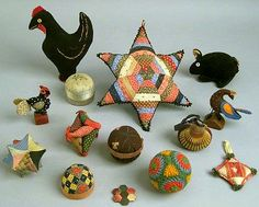 Group of old needlework pin balls and pin cushions.