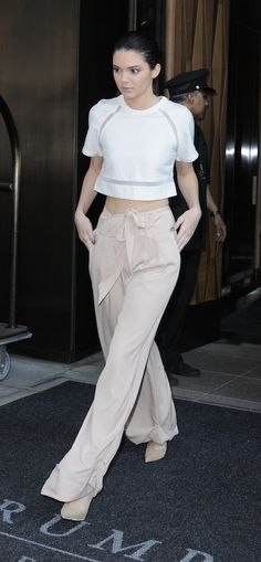 Kendall had legs for days when she was spottedleaving the Trump Hotel in a pair of wide-legWhitney Evetrousers. Her boxyThree Floorcropped tee with sheer inserts at the sleeves and hem further enhanced the effect of this neutral ensemble.Photo: TNYF/WENN.com