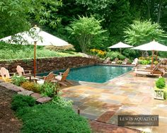 Great pool idea with stone retaining wall.