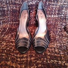 Black heels with silver scalloped edges Black heels with a scalloped side and back , used but with life left in them Shoes Heels