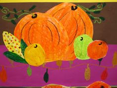 Draw apples, pumpkins, and corn on a piece of white paper.  Everything was then colored with oil pastels.  I encouraged my students to experiment with mixing and blending analogous colors.  Next, we cut all of these vegetables out and glued them to construction paper.  Lines, Dots, and Doodles: 3rd Grade