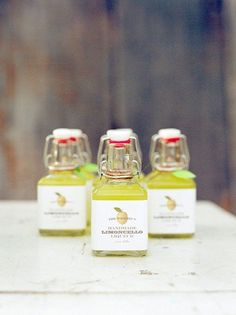 Brides: Mini Bottles of Homemade Limoncello. If you're up for a DIY project, consider whipping up some homemade limoncello. Send guests home with a bottle and they'll surely remember your big day while they're sipping it at home. Creative Wedding Favors, Inexpensive Wedding Favors, Cheap Favors, Wedding Favors For Guests, Wedding Favor Tags, Wedding Thank You, Wedding Gifts, Wedding Ideas, Table Wedding