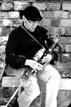 Mac playing the Uilleann Pipes.