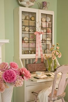 The perfect spot for a girl to unwind ✿⊱╮I love the vintage secretary and the whimsy of the clock collection.