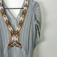 Free People • Beaded Tunic Top Beautiful gray oversized top with a mix of solid and sheer material and a soft draping fit. Amazing beadwork and embroidery detail. Has slit, short cap slfrayed hem. Double v-neck. Gorgeous with a black bralette and your favorite skinny jeans!  ➳ 53% Polyester, 47% Cotton   ➳ Bust - Approx 26 inches armpit to armpit ➳ Length - Approx 32 inches shoulder to hem  ➳ Excellent gently preloved condition with no rips, holes or stains.  ☾ No holds, No trades, Poshmark…