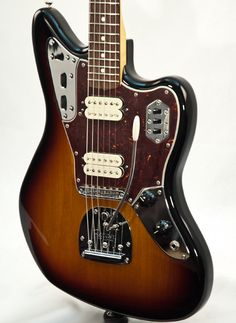 The concept and look of this guitar is growing on me. I'd like one with black scratch plate and black pickups... Fender Classic Player Jaguar Special HH Electric Guitar