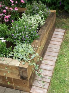 a Raised-Bed Vegetable Garden DIY Network has step-by-step instructions on how to build a raised garden bed using landscape timbers.DIY Network has step-by-step instructions on how to build a raised garden bed using landscape timbers. Raised Garden Bed Plans, Building A Raised Garden, Raised Bed Planting, Raised Bed Diy, Plants For Raised Beds, Brick Edging, Lawn Edging, Brick Border, Wood Edging