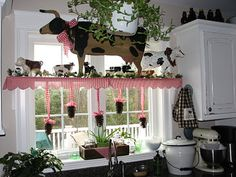 I love the gingham fabric and the hanging pinecones (from Folded Gingham)