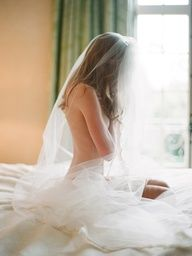 I love the idea of bringing a chapel-length veil to a boudoir session. Photo by Elizabeth Messina.