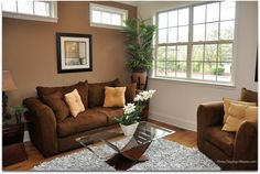 Great use of a small living room- love how the light color of the wall elongates it.