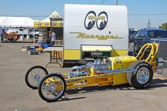The original 1961 Mooneyes Moon Yellow A/Dragster still exists  The original car was retired to Florida at the Don Garlits Museum of Drag Racing, and a replica was ordered by Mooneyes from Dode Martin (the original chassis builder) and temporarily resides in the NHRA Museum.  NHRA 22nd Annual California Hot Rod Reunion October 18th to the 20th 2013  Auto Club Famoso Raceway  33559 Famoso Rd. McFarland CA. Near Bakersfield, CA.