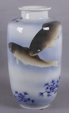 """A Large Japanese Porcelain Vase, Fukagawa -  Description: Early 20th century, with hand painted decoration depicting carp on a blue ground with vegetation. Blue orchid mark at the base. 11"""" in diameter x 21 1/2"""" tall."""