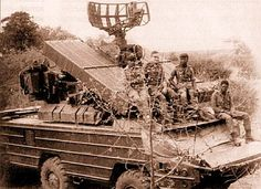 """Angolan soldiers and Soviet officer pose on their """"OSA"""" air-Defense vehicle after successfully repelling a South African air raid. Locale is the provinces of Rio de Areia and """"Shimbemby"""" [sic]. Cuba, South African Air Force, Air Raid, Defence Force, African History, Military History, Armed Forces, Military Vehicles, Cold War"""