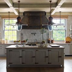 Rustic kitchen.   I LOVE THIS!!  The vent hood cover and hinges are awesome.