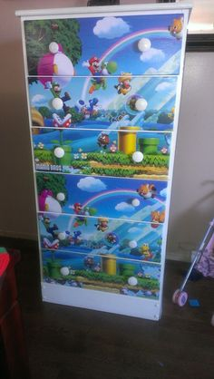 Used old dresser, bought poster, cut it to fit with exacto knife then mod podged it to front of dresser drawers. . . VOILA!