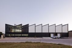 Completed in 2014 in Zapopan, Mexico. Images by Onnis Luque. We wanted to propose a building that was able to communicate its industrial condition through the architectural elements. So we recalled a couple of. Factory Architecture, A As Architecture, Watercolor Architecture, Industrial Architecture, Commercial Architecture, Contemporary Architecture, Building Exterior, Building Facade, Building Design