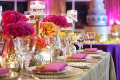St. Petersburg Indian Wedding Reception Table Decor with Pink and Yellow Flower Centerpieces Gold Linens and Candles | St. Petersburg Wedding Florist Iza