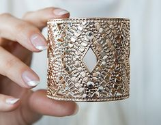 A constellation of cutouts gives this chunky cuff a surprising lightness. #etsyjewelry