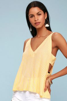 Lulus Exclusive! Get lost at sea and enjoy every minute in the Lulus Adrift Mustard Yellow Striped Tank Top! Lightweight mustard yellow and white striped woven rayon has a perfectly fun look over double spaghetti straps, and a wide-cut triangle bodice with cute side cutouts, and a tying back.