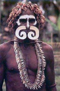 Papua New Guinea | Asmat Warrior | Scanned postcard.