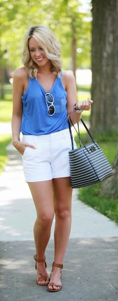 a52ad561a95 Famous white casual shorts with top blue loose blouse and stripes leather  hand bag and brown leather sandals and goggles the best street sty.