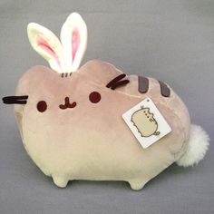This Pusheen is dressed as a little bunny, how cute! He's got super soft bunny ears coming out of his head and the softest little tail as well! Pusheen Toys, Pusheen Plush, Plushies, Things To Buy, Piggy Bank, Bunny, Script, Cute, Ears