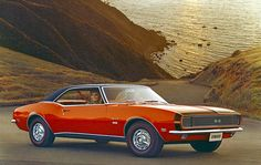 """Chevrolet  Camaro. One of the original '60s muscle cars, the first-generation Camaro featured a """"virtual race ready"""" version with engines that ranged up to 400..."""