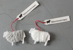 Sheep templates wrapped in yarn 'wool'