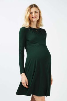 d6e96ad623 Accentuate your growing bump in this chic drape neck skater dress for  Maternity. With a