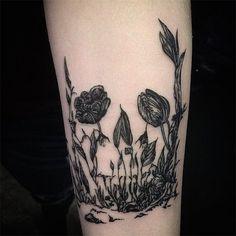 Skull/flower tattoo - The tattoo has a subtle hint of a skull. Makes this tattoo interesting. #TattooModels #tattoo