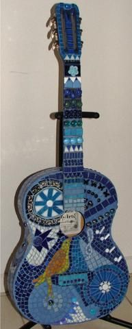 Mosaic guitars are really fun to make and great conversation pieces. If you have an old or damaged guitar it can be repurposed into a beautiful mosaic.