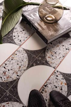 Circle terrazzo floor tile This tile mosaic from Mosaique Surface is giving off mid-century vibes with the half-circle pattern