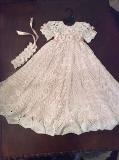 A crochet christening gown baby pattern for the serious crochet maker. This pattern will take a good 60-70 hours to complete. This is a very lovely pattern that once finished will be an heirloom for sure. This gown will fit a baby 3-12 months old. The gown measures 31 inches long and