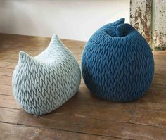 Designed by Aleksandra Gaca, 2011. The poufs are made in a three-dimensional elastic fabric and their shapes are highly flexible. They take the form of your body when you sit on them and they spring back to their original shapes when you get up. The soft knit fabric is made of Kid Mohair.These
