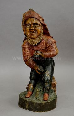 a whimsical carving of a dwarf with snuffbox 19th century