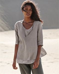 Poetry - Linen and jersey top - This is a fresh and contemporary piece that pairs our crinkle linen with its cool texture and soft colour over a linen jersey vest thats slightly longer at the hemline. With a scoop neckline that can be left open to show the contrasting colour beneath, the sleeves finish at the elbow. 82% linen 18% cotton. Lining 100% linen jersey