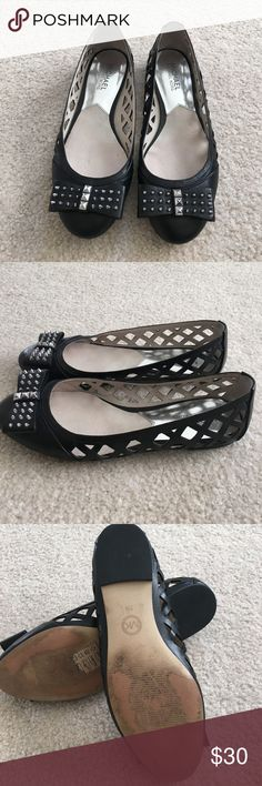 Michael Kors Larissa Studded Bow Flats These edgy ballet flats are in great gently used condition. The only signs of wear are on the bottom of the shoes. Made of soft black leather uppers, woven cutout detail on the sides, and a silver studded bow on the toe. Michael Kors Shoes Flats & Loafers