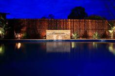 Albatross Pool with pool waterfall and bamboo pool fencing in Rowville - Modern Backyard Pool Landscaping, Pool Fence, Backyard Fences, Swimming Pool Designs, Swimming Pools, Screened Pool, Rectangle Pool, Pool Waterfall, Old Fences