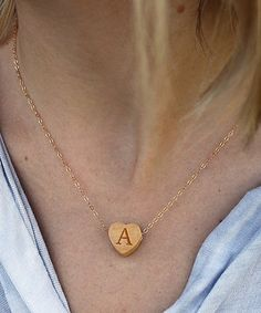 $22.99 marked down from $30! Natural Wood & Gold Initial Heart Pendant Necklace #wedding #boho #wood #heart #wedding #bridesmaid #gift #personalized #initial #zulilyfinds