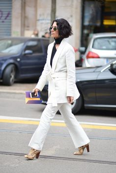 A white pant suit paired with nude heels