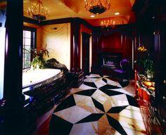 A romantic #bathroom enhanced by a #fireplace.