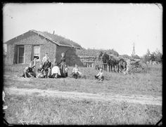 J.C. Tobias family in front of sod house, Sargent, NE, 1886