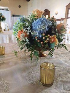 Blue, Peach, & Gold Wedding Centerpiece :: The Vines Flower & Garden Shop