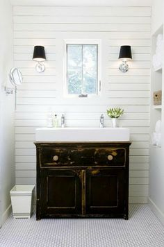 like the horizontal paneling and sconces  An Urban Cottage  This is Exactly what I want in my little bath!  I'm going to have to find an antique cabinet and have it made, I'm sure.