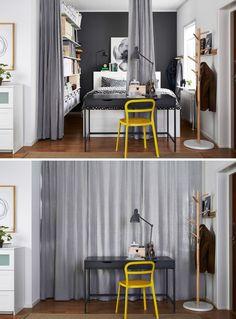 Hálószoba függönnyel leválasztva, szürke fallal, sok tárolóhellyel - polcok egy teljes falon, fiókokkal az ágy alatt.
