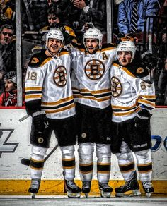 patrice bergeron, nathan horton, and brad marchand celebrate a goal