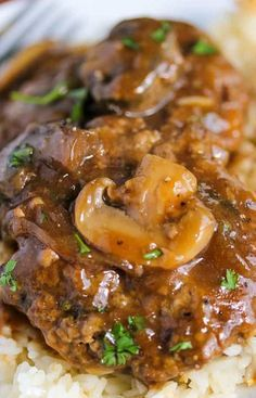 This is a very popular recipe. Ground beef with mushrooms, ketchup and beef broth cooked in a slow cooker. Very delicious! #crockpot #salisbury #steak #beef