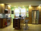 Cabinets all the way up to the ceilings.  Like the oak color with light floors.  From the Cabinet discounters gallery.