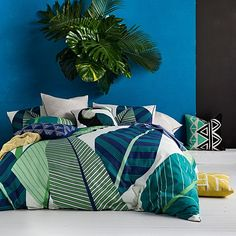 Transform your bedroom into a tropical oasis with the spirited green colour of the cotton slub Miconia Quilt Cover Set from KAS.