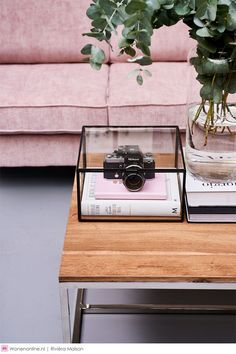 I love the way the camera has been made a feature in this living room - it would be perfect styling for an office. The pink and green are a perfect match too!